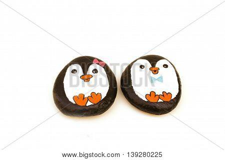 Girl and Boy penguin rocks for the garden