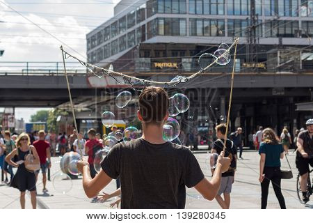 Soap Bubble Performer On Alexanderplatz In Berlin
