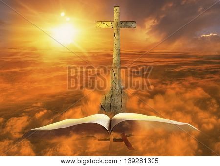 wooden cross coming out of a bible and going skyward