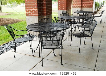 outdoor steel lunch tables and chairs outside office building
