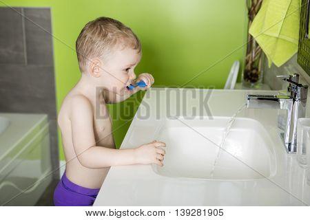 A kid or child  brushing teeth in bathroom