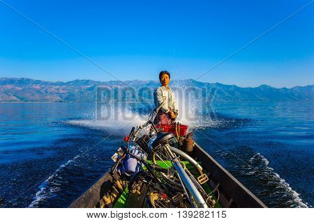 Inle, Myanmar-December 27: Local people in Inle lake usually travel by old style motor boat across the famous lake of Myanmar on December 27, 2013