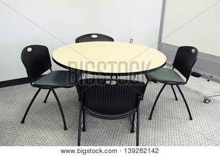 table and chairs in the lobby of university building