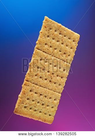 isolated cracker cookie on blue and pink background