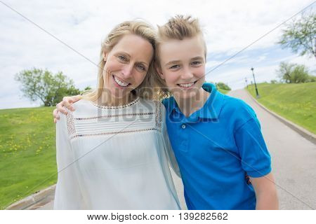 A summer portrait of mother and son outside on a road