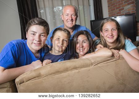 A Family Relaxing Indoors Watching Television Together