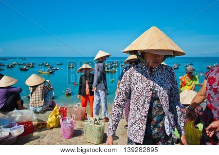 MUI NE, VIETNAM-APRIL 12: A famous tourist destination in southern of Vietnam is the fisherman village that tourists can see the crowding of fishing boats on April 12, 2012