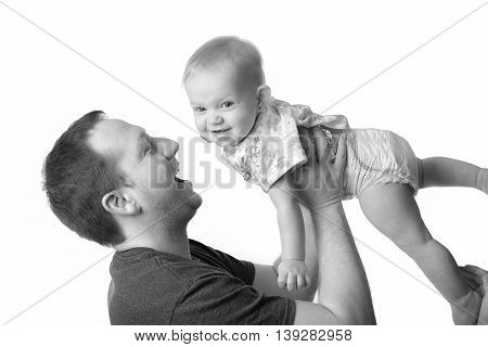 A Happy young father playing with little daughter