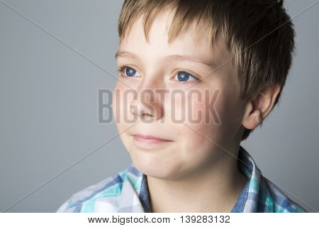 A closeup portrait of a beautiful kid grey background studio