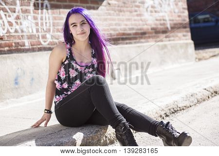 A girl outside portrait with purple hair