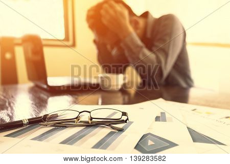Bussiness Depressed businessman in office Bussiness concept soft focus vintage tone