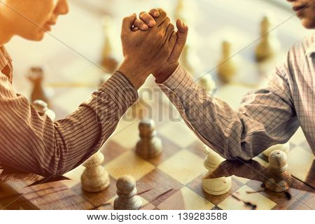 Business two businessmen arm wrestling in a competitive businessม business concept soft focus vintage tone