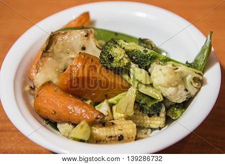 Stewed vegetables in served a white bowl