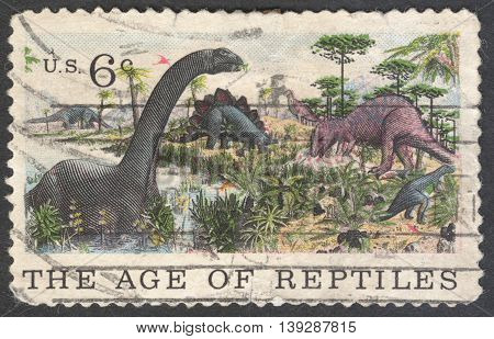 MOSCOW RUSSIA - JANUARY 2016: a stamp printed in the USA shows Apatosaurus Stegosaurus & Allosaurus the series