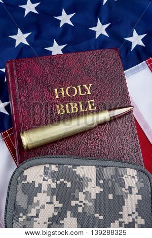 Religion and peace with fifty caliber bullet bible and American flag with room for your type.