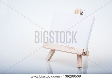 Small Easel With A Blank Canvas Over White