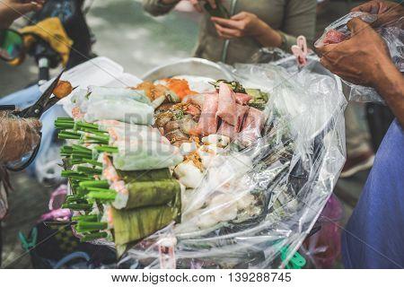 Vietnamese street food. Traditional spring rolls. Food vendor in Saigon Vietnam.