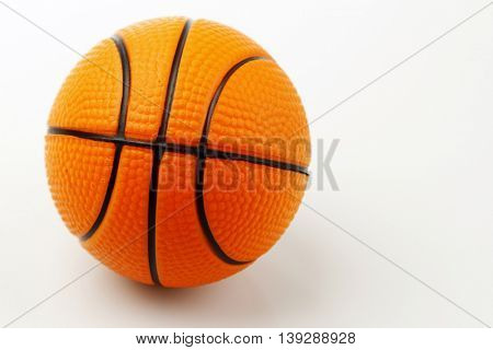 One basketball on plain background