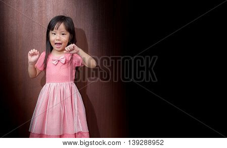 Portrait Of Happy Little Girl Showing Two Hands