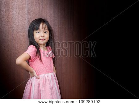 Portrait Of Asian Happy Little Girl , Akimbo