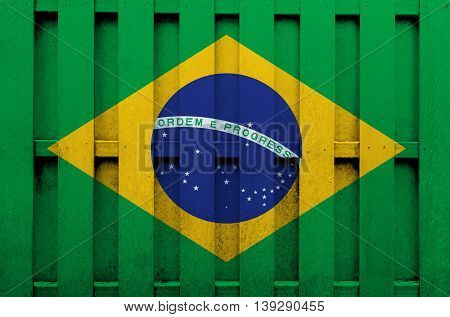 Flag of Brazil painted on wooden fence. background texture