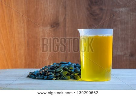 seeds with shells and sunflower oil in a glass
