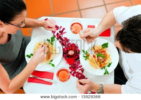 Couple at lunch or dinner; very romantic setting