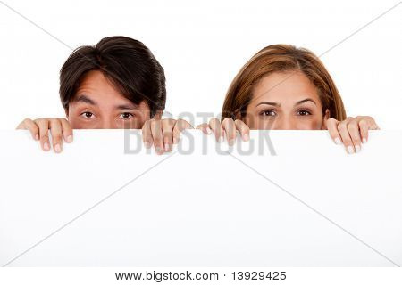 Couple holding a banner and hiding half their face - isolated
