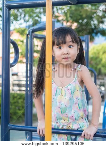 asian baby child playing on playground surprise action big eyes