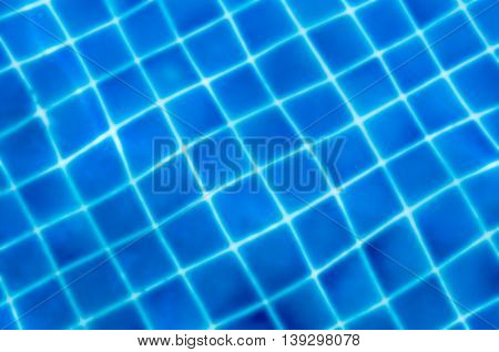 blurred of blue mosaic tiles under water