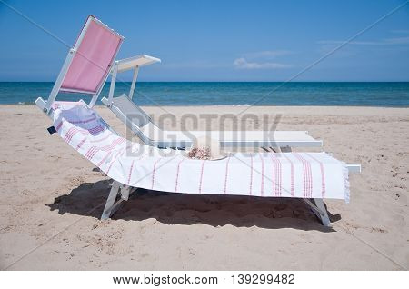 beautiful and colorful sun beds for sunbathing on the beach