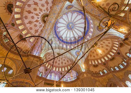 Istambul - The Sultan Ahmed Mosque, popularly known as the Blue Mosque. The ceiling with paintings. Travel Turkey.
