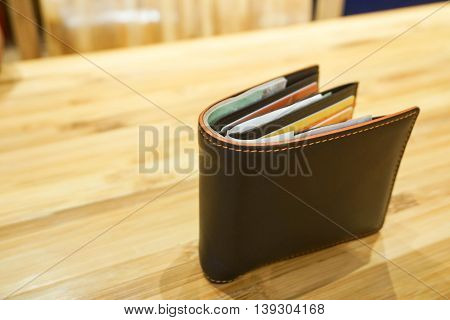 Brown man wallet on the wooden table