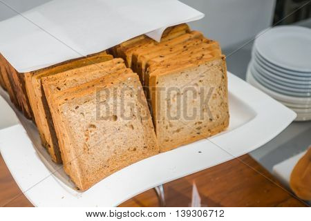 Slices of bread on table in buffet