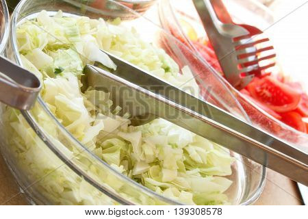 Fresh lettuce in a plate. Ingredients for Salad