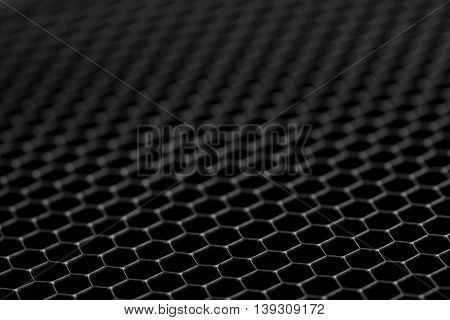 Black background of circle pattern texture close up