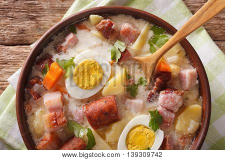 Polish Zurek Soup With Sausage, Vegetables And Eggs Macro. Horizontal Top View