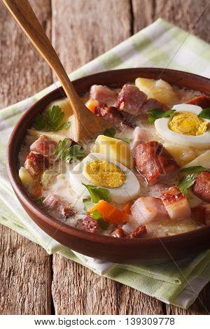 Polish Food: Zurek Soup With Sausage Close-up. Vertical