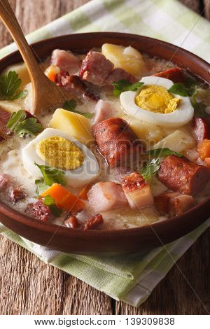 Delicious Polish Soup Zurek With Sausage And Eggs In A Bowl. Vertical
