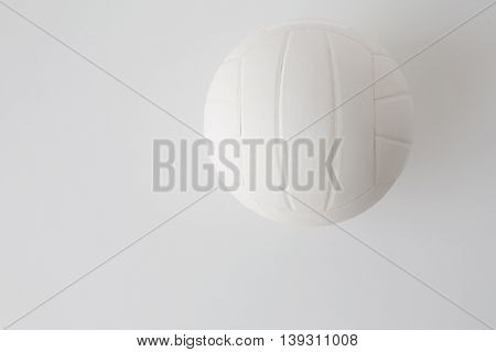 sport, fitness, game, sports equipment and objects concept - close up of volleyball ball on white