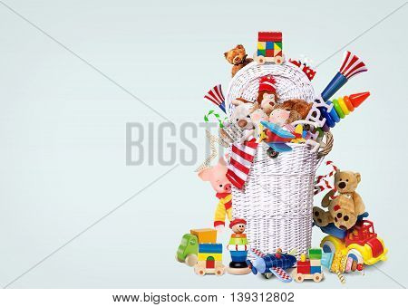White wicker basket full of toys and gifts
