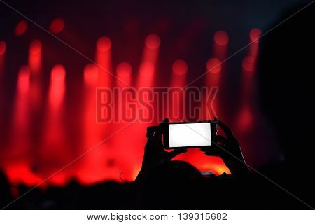 Close Up Of Recording Video With Smartphone During A Concert With Blank White Screen