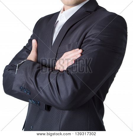 Silhouette of a businessman to his waist in black suit hands folded on his chest. On isolated background.