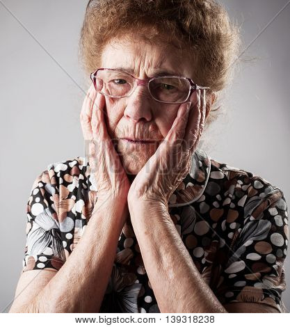 Portrait  old woman. Sad adult female. Grandmother