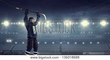 Hockey player on ice   . Mixed media