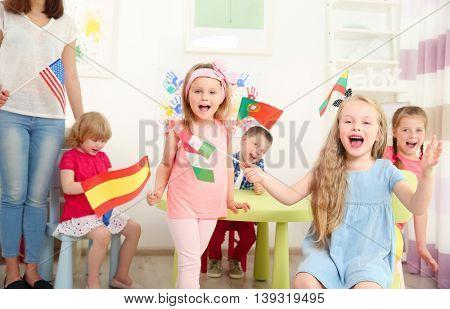 Children with flags in kindergarten