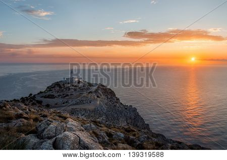 Lighthouse at Cap de Formentor on Mallorca Majorca at the sunrise in the dusk