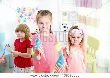 Children and American flag in kindergarten