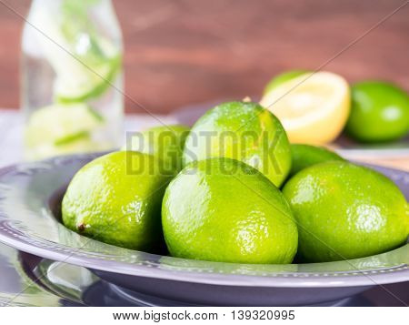 Whole Green Limes In A Plate