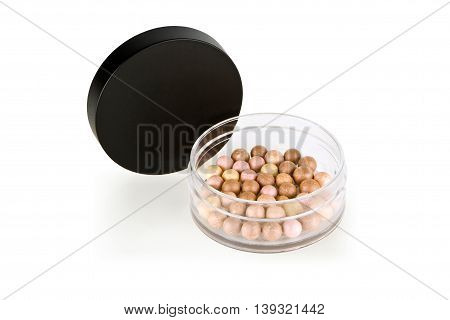 Face Powder Pearls, in an open container, Isolated on White
